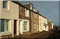 NU2520 : Cottages, Craster by Derek Harper
