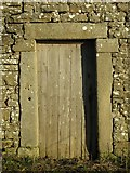 NY9539 : Old door at High Farm by Mike Quinn