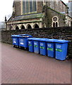 SS7597 : Blue wheelie bins alongside a churchyard perimeter wall, Neath by Jaggery