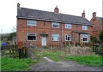 TA3719 : Houses on Church Road, Skeffling by JThomas