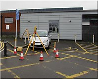 SS7597 : Tripod and surveying instrument outside Neath railway station by Jaggery