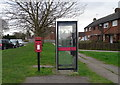 SE6334 : Elizabeth II postbox and telephone box on York Road, Barlby by JThomas