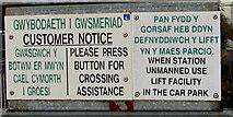 SS7597 : Welsh/English notice alongside Neath railway station barrow crossing access gates by Jaggery