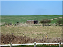 SU2562 : Pillbox overlooking canal crossing by Robin Webster