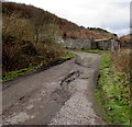SS9398 : Large pothole on a Treherbert side road by Jaggery