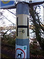 SH5873 : Hydrant sticker on sign post on Siliwen Road, Bangor by Meirion