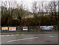 SS9596 : Four banners on railings on the approach to Abergorki Industrial Estate, Treorchy by Jaggery