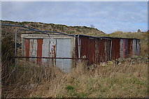 NJ9402 : Derelict Sheds by Anne Burgess
