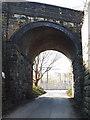 SE2634 : Disused railway bridge over Redcote Lane, looking west by Stephen Craven