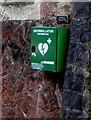 SS5889 : Green defibrillator box on a church wall, Murton by Jaggery