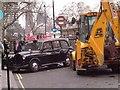 TQ3180 : JCB & Taxi in Arundel St by Glyn Baker