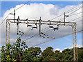 SJ9528 : Electrification gantry near Salt, Staffordshire by Roger  Kidd