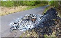 NO3408 : Burned-out caravan by Bill Kasman