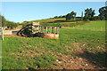 SO5478 : Feeder and pen near The Hills by Derek Harper