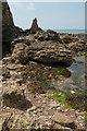 SX6643 : Rocks near the Long Stone by Derek Harper