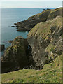 SX9250 : Cliffs and rocks east of Ivy Cove by Derek Harper