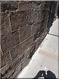 SX9192 : Benchmark, wall of St Olave's church, Exeter by David Smith