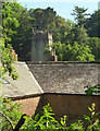 SX8963 : Stable roofs and church tower, Cockington by Derek Harper