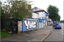 SK5802 : Graffiti on wall on east side of Saffron Lane north of Shakespeare Street junction by Roger Templeman