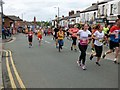 SJ9594 : Dr Ron Hyde 7 Mile Race 2019: Runners on Market Street by Gerald England