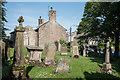 NY9913 : Gravestones at north-west corner of graveyard by Trevor Littlewood