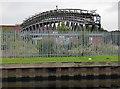 SE4326 : Disused pipe bridge over the River Aire by Chris Allen