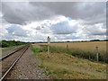 TL5356 : Railway, footpath and distant turbines by John Sutton