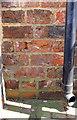 SE3994 : Benchmark on 5/6th bricks above ground on Bullamoor Farm House by Luke Shaw