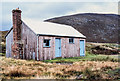 NN6986 : Wooden estate building near Allt Coire Chuaich by Trevor Littlewood