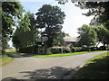 TA0552 : Corpslanding  Road  goes  left  Rotsea  Lane  swings  right by Martin Dawes