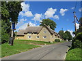 SP3724 : Pub sign and thatched cottage, Enstone by Malc McDonald