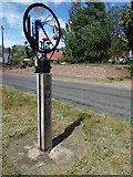 TG1022 : Booton Village sign by Geographer