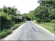 TG1022 : Entering Reepham on Norwich Road by Geographer