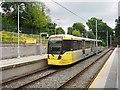 SJ8491 : Manchester Metrolink tram at West Didsbury tram stop by Graham Hogg