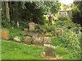 NS5472 : Gravestones, New Kilpatrick Parish Church by Richard Sutcliffe