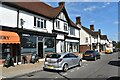 TM1945 : Parade of shops, Woodbridge Road East by Simon Mortimer