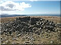 SH6469 : Cairn at the summit of Moel Wnion and triangulation pillar remains, Llanllechid by Meirion