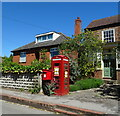 TF4369 : Elizabeth II postbox and telephone box on Main Road, Skendleby by JThomas