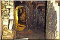 SJ8383 : Quarry Bank Mill, Styal - flue to the chimney by Chris Allen