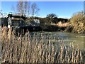 TF3902 : Flood water surging under Rings End sluice - The Nene Washes by Richard Humphrey