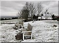 SO5975 : Frozen seats at the Clee Hill viewpoint by Mat Fascione