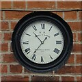 SO8737 : Clock on a house front by Philip Halling