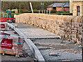 SD7915 : Laying Footway at Kay Street Bridge by David Dixon