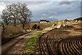 NH6354 : Harrowed field on the approach to Balnaguie by Julian Paren