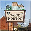 TG0127 : Wood Norton village sign by Adrian S Pye