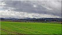 NH5757 : Fields of Drummondreach and distant mountains by Julian Paren