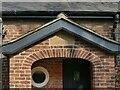 SJ8067 : Datestone on the former Swettenham village school by Stephen Craven