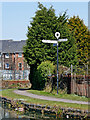 SO9591 : Towpath and signpost at Tipton Junction, Sandwell by Roger  Kidd