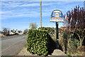 TF5113 : Walpole Highway village sign by Adrian S Pye