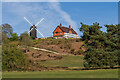 TQ2350 : Reigate Heath Windmill and Reigate Heath Golf Club clubhouse  by Ian Capper